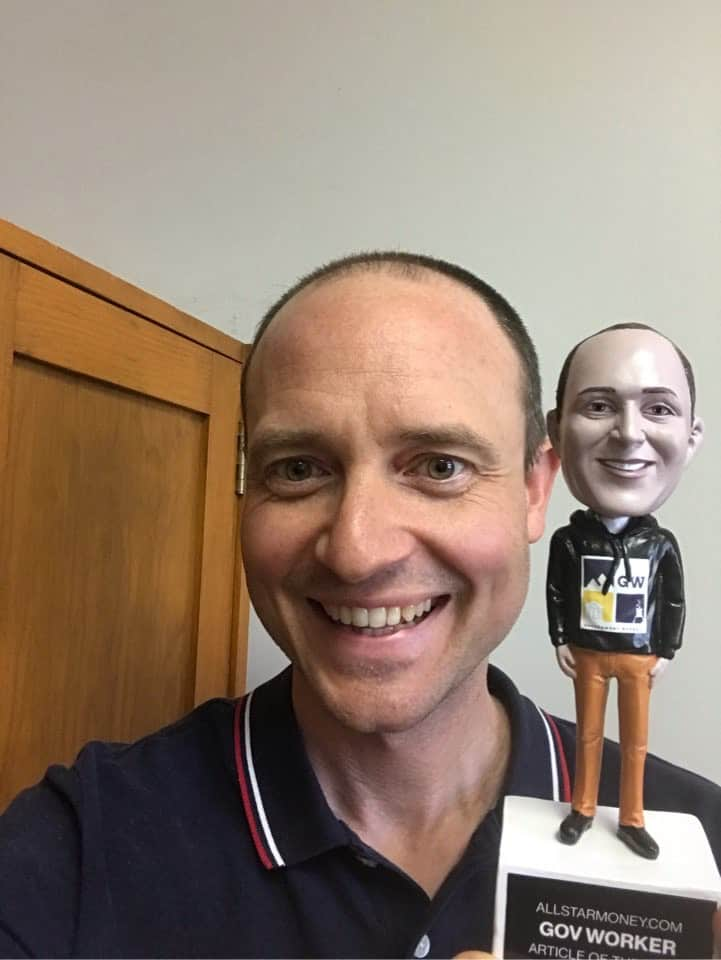 gov worker with a bobblehead